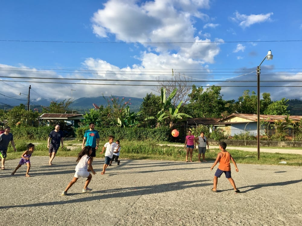Camp Aftermath volunteers playing soccer with local children in Golfito